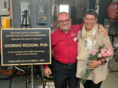 Giorgio and Kathy Rizzoni with anniversary plaque